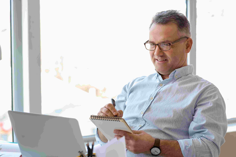 mature-man-using-laptop-at-home